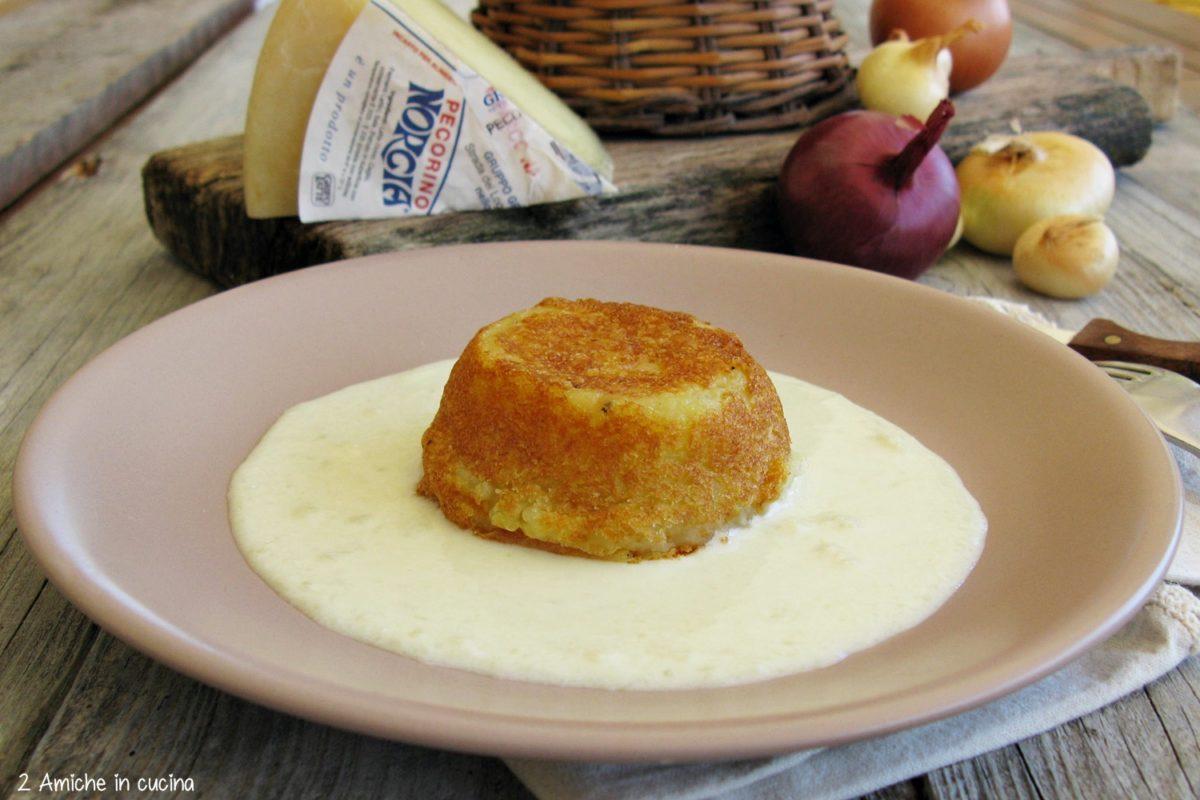 Tortino di patate e cipolle con fonduta di pecorino di Norcia, ricetta con prodotti tipici umbri