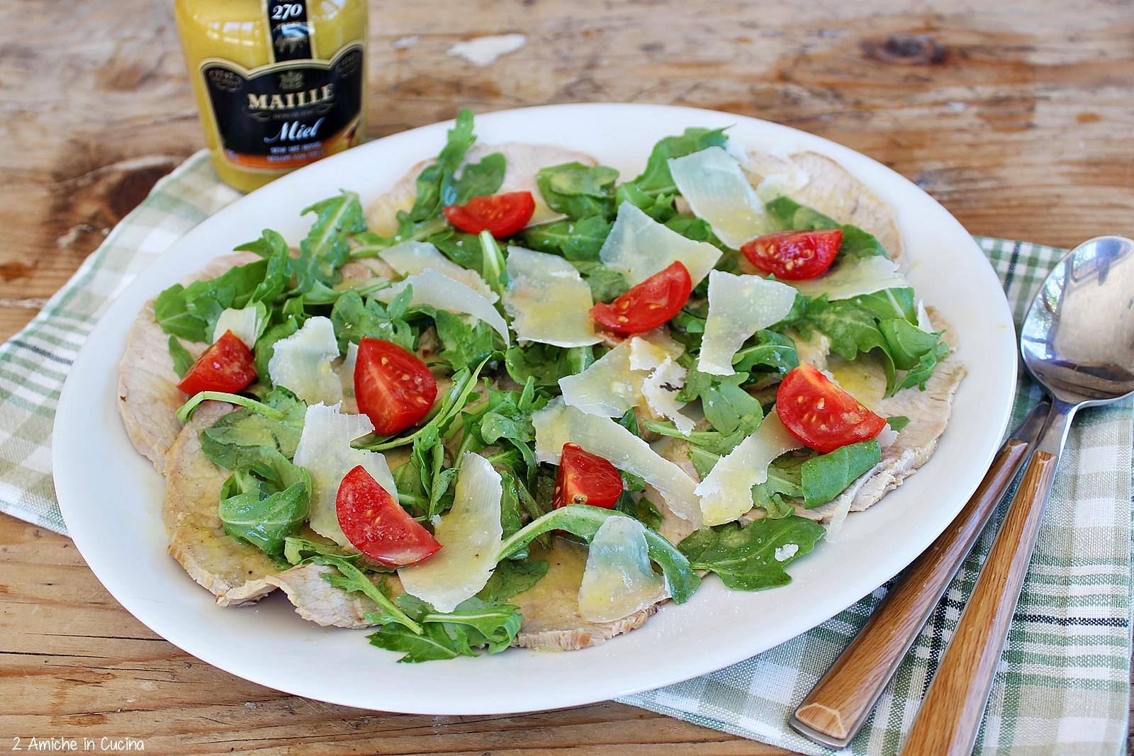 arista alla senape con rucola, parmigiano e pomodorini