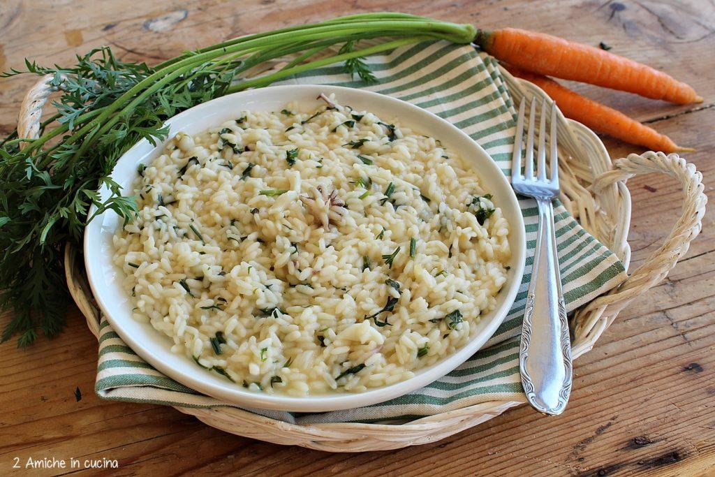 Risotto con foglie di carote e seppioline