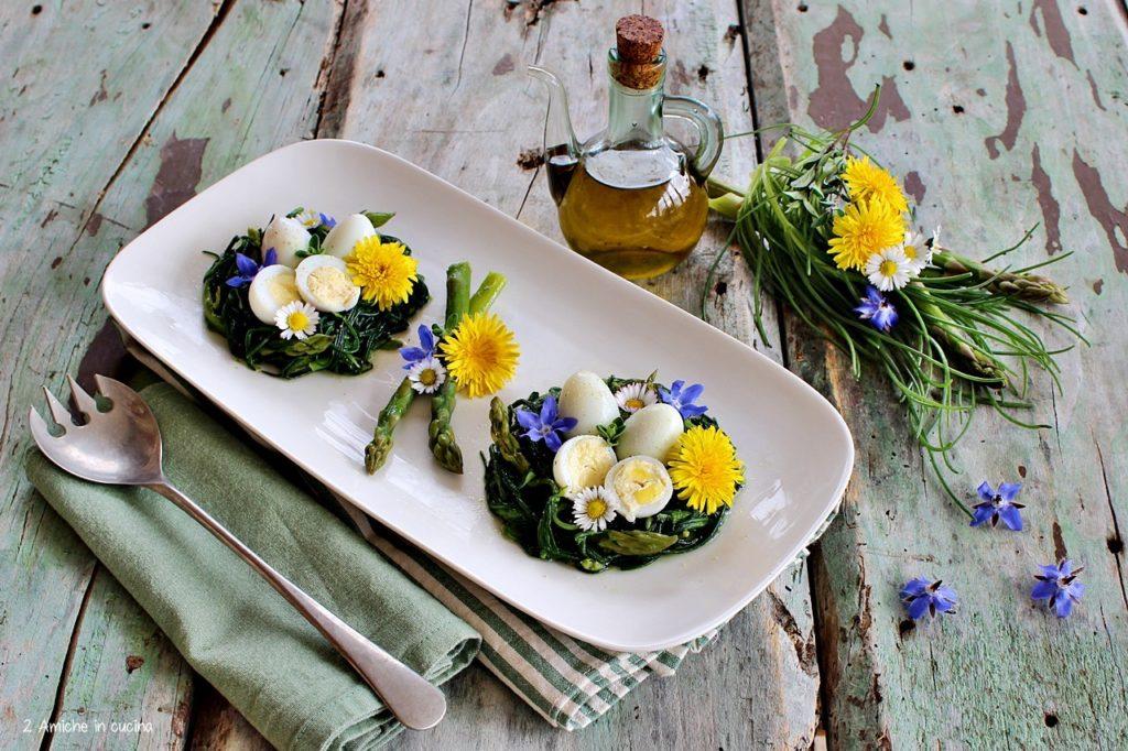 Nidi di agretti con asparagi, uova di quaglia e fiori