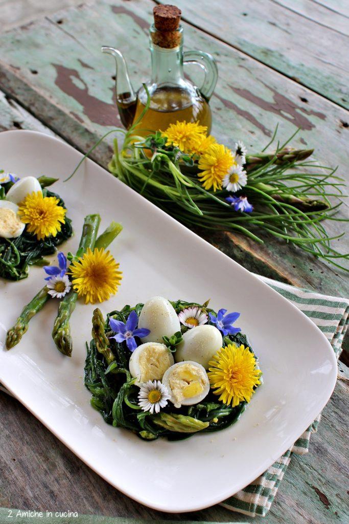Agretti e asparagi con uova di quaglia sode e fiori di campo