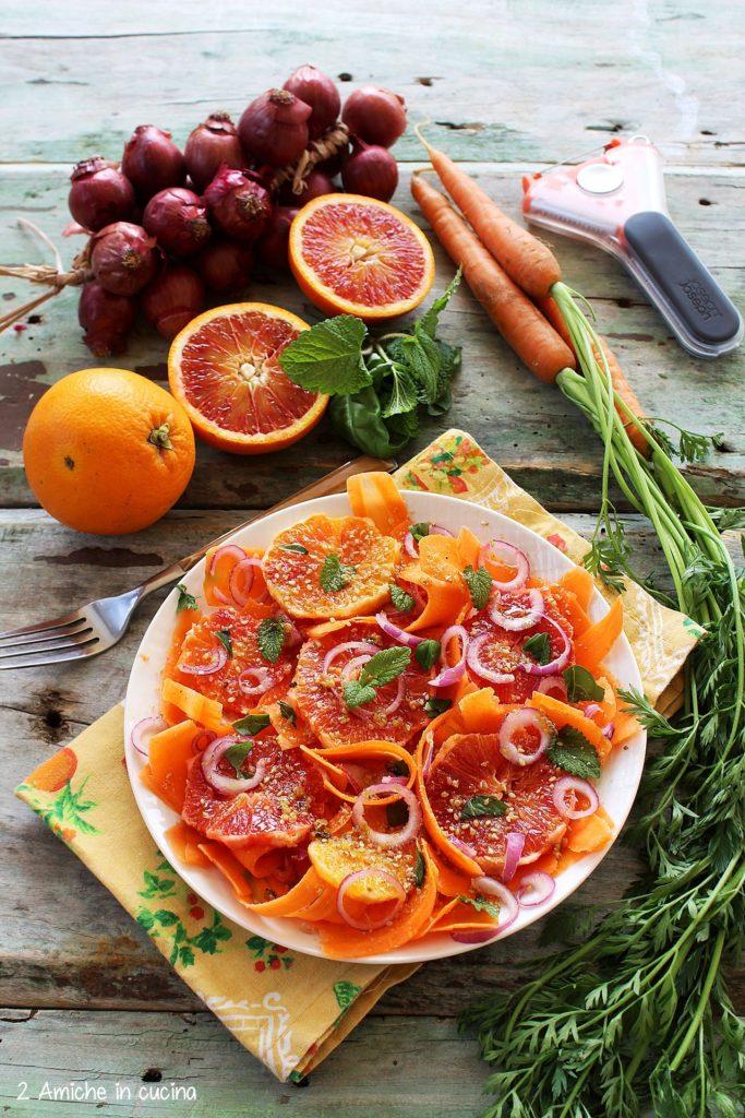 Ricetta per un contorno light con carote e arancia