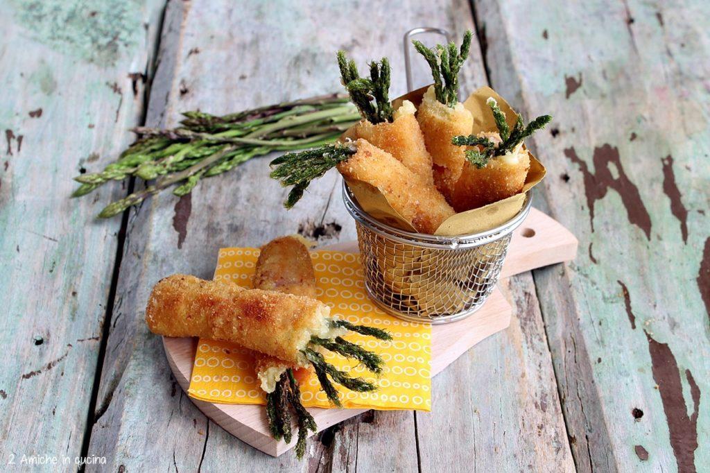 Rotolini di cotto, formaggio e asparagi fritti, antipasto sfizioso