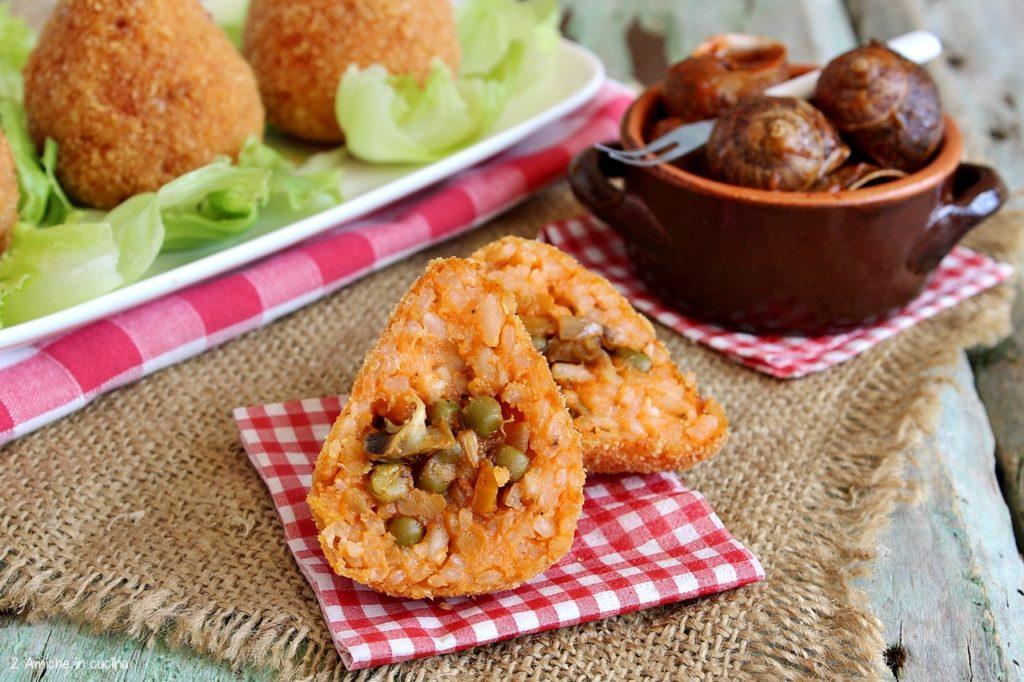 Arancini con lumache ripieni di piselli e carote