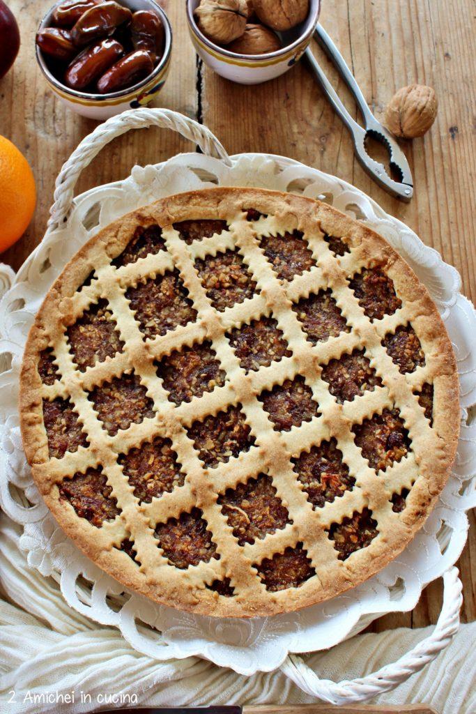 Crostata con frutta secca, mele e arancia