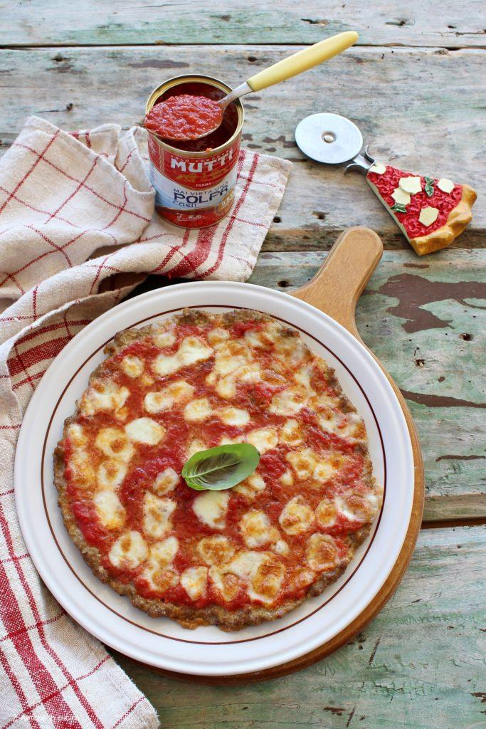 Pizza di carne con pomodoro Mutti